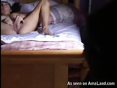 Relaxing on sofa and stroking her accurate bald vagina
